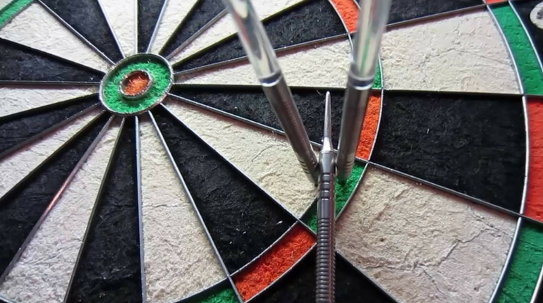 make darts stick to dartboard